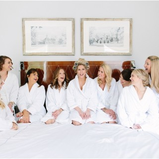 bridal-photo-bed-bridesmaids-robes-rollers