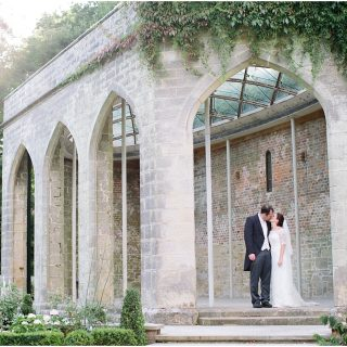 Bride and groom in orangery at Chiddingstone Castle