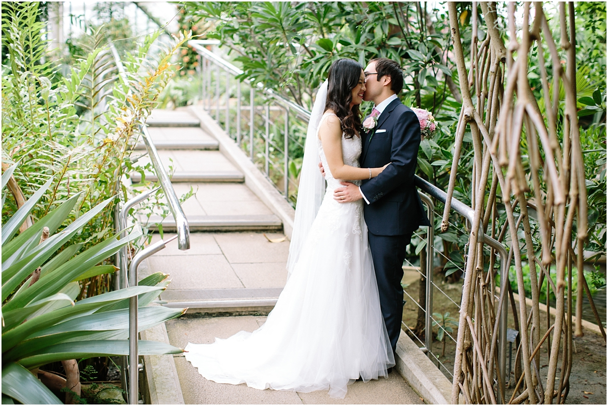 Bride and groom in greenhouse at Kew Gardens