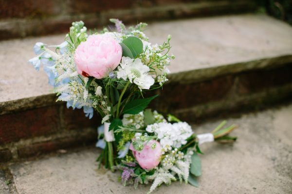 Bridesmaids bouquets in pink, blue white and green