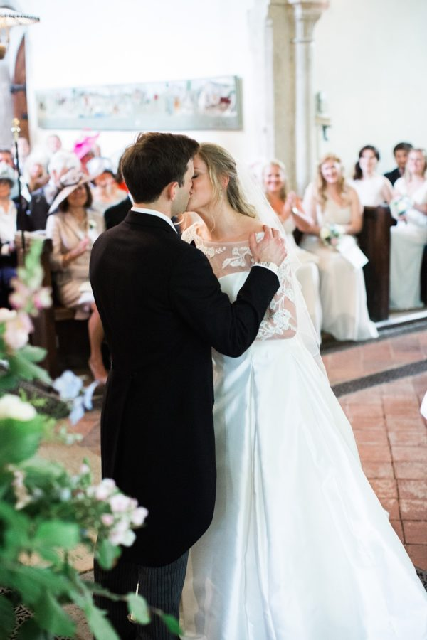 First kiss of bride and groom during wedding service