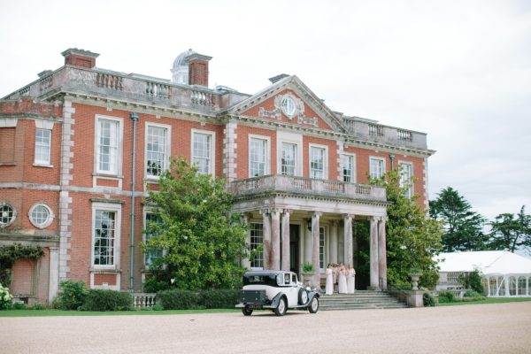 Bride and groom arriving at Stansted House wedding venue