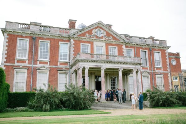 Stansted House wedding venue with guests mingling outside
