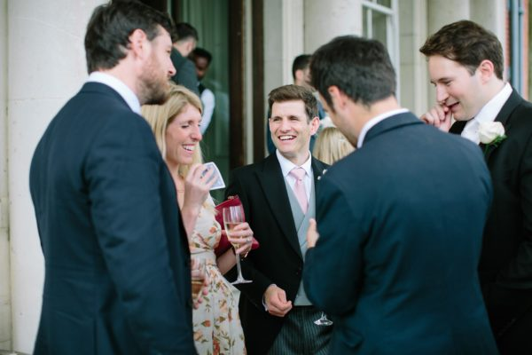 Groom chatting to wedding guests at Stansted House wedding