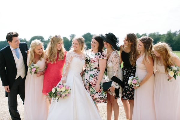 Bride with friends captured by Stansted House wedding photographer Camilla Arnhold