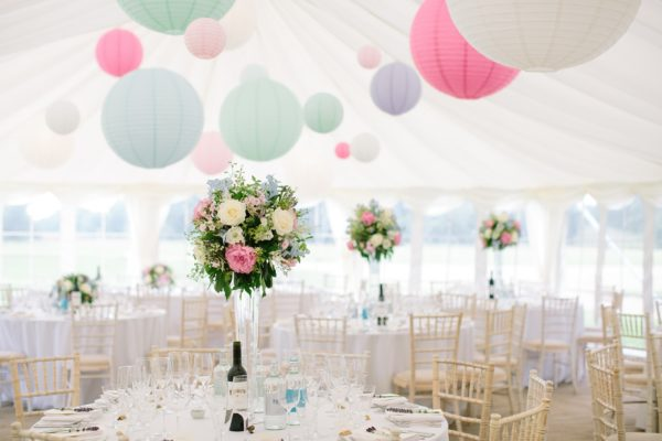 Wedding marquee set up for wedding breakfast captured by Stansted House wedding photographer