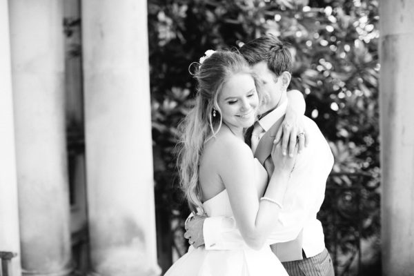 Black and white photograph of bride and groom in romantic embrace by Stansted House wedding photographer Camilla Arnhold