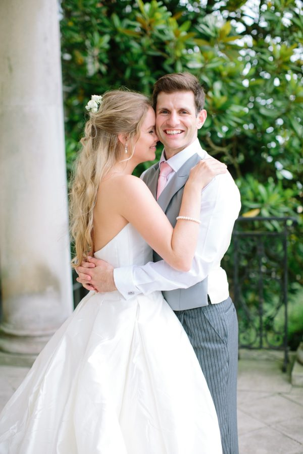 Natural photograph of bride and groom laughing at Stansted House wedding