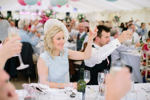 Wedding guests toasting during wedding speeches at Stansted House