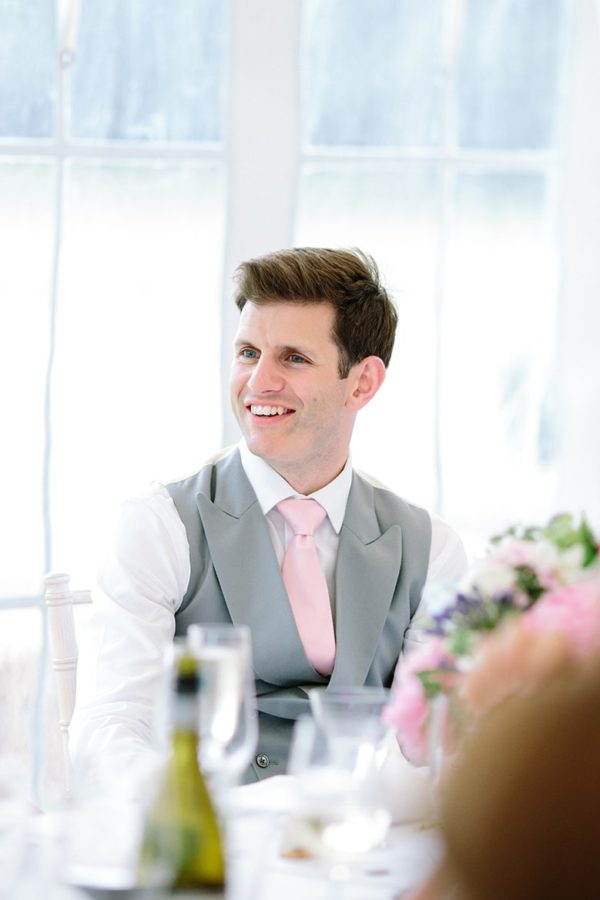 Groom smiling during wedding speeches at Stansted House wedding