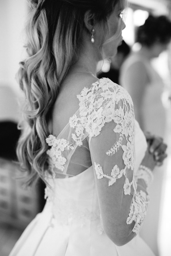 Lace detail on the shoulder of Sassi Holford wedding dress