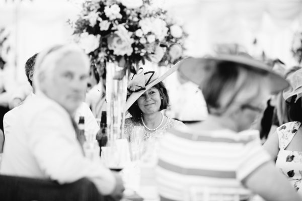 Black and white photograph of mother of the bride looking proud during wedding speeches