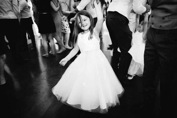Flower girl dancing at Stansted House wedding