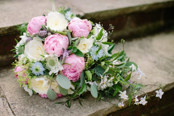 Natural pink, cream, blue and white cascading wedding bouquet