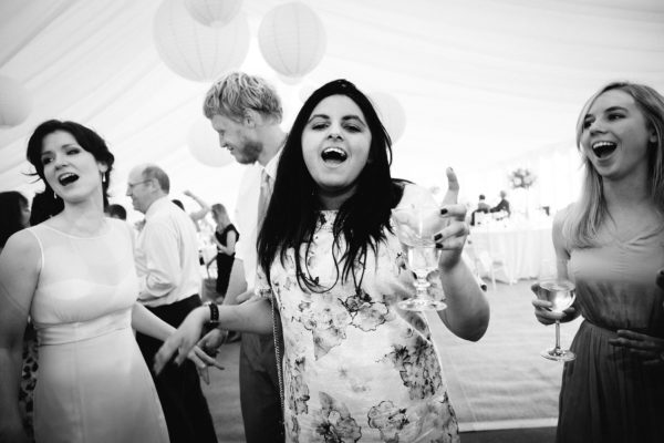 Wedding guests dancing and singing at Stansted House wedding