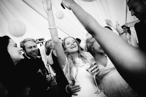 Bride dancing with her friends at Stansted House wedding