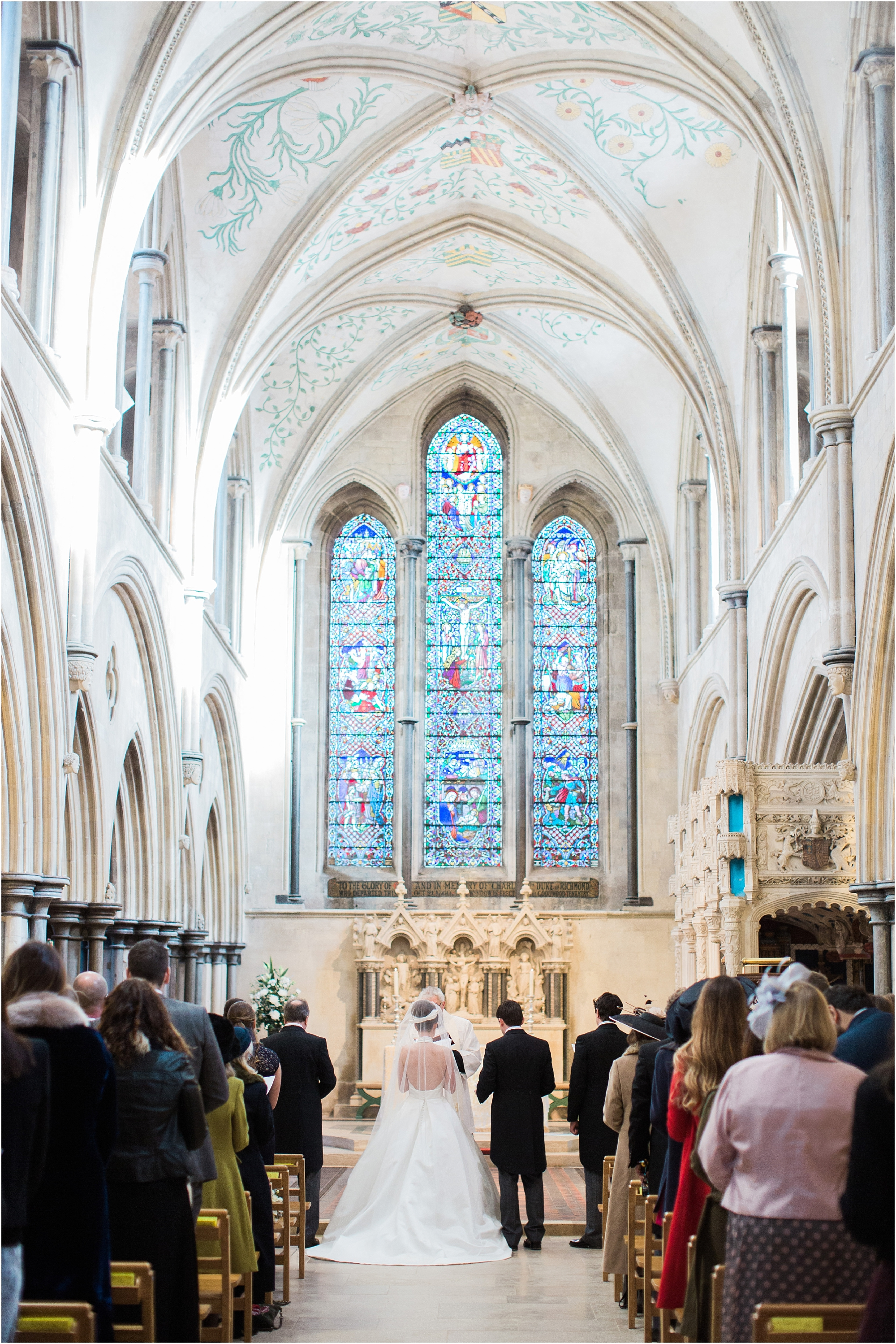 Bride and groom during wedding ceremony at altar of Boxgrove Priory