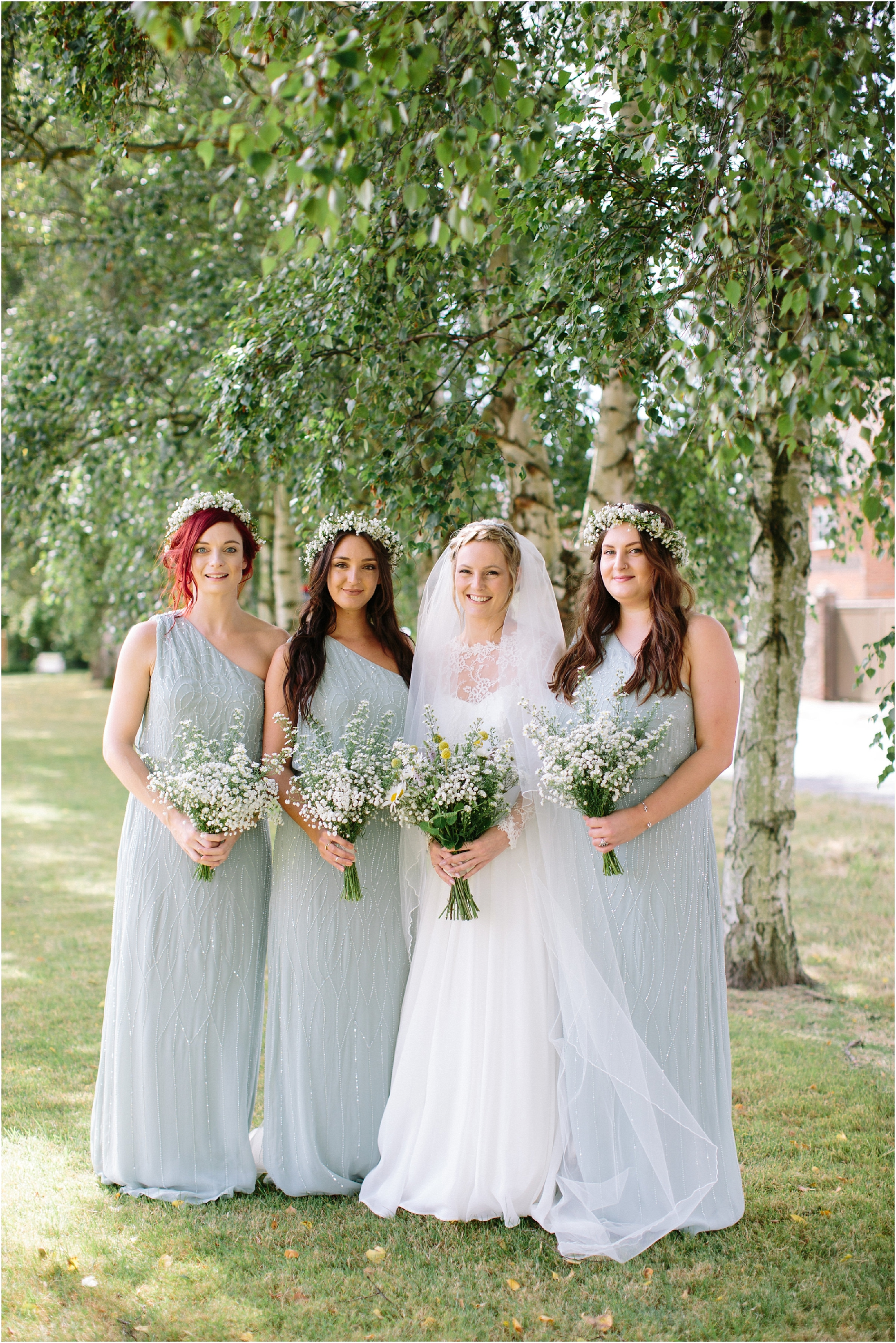 Bridesmaids in mint green beaded dresses