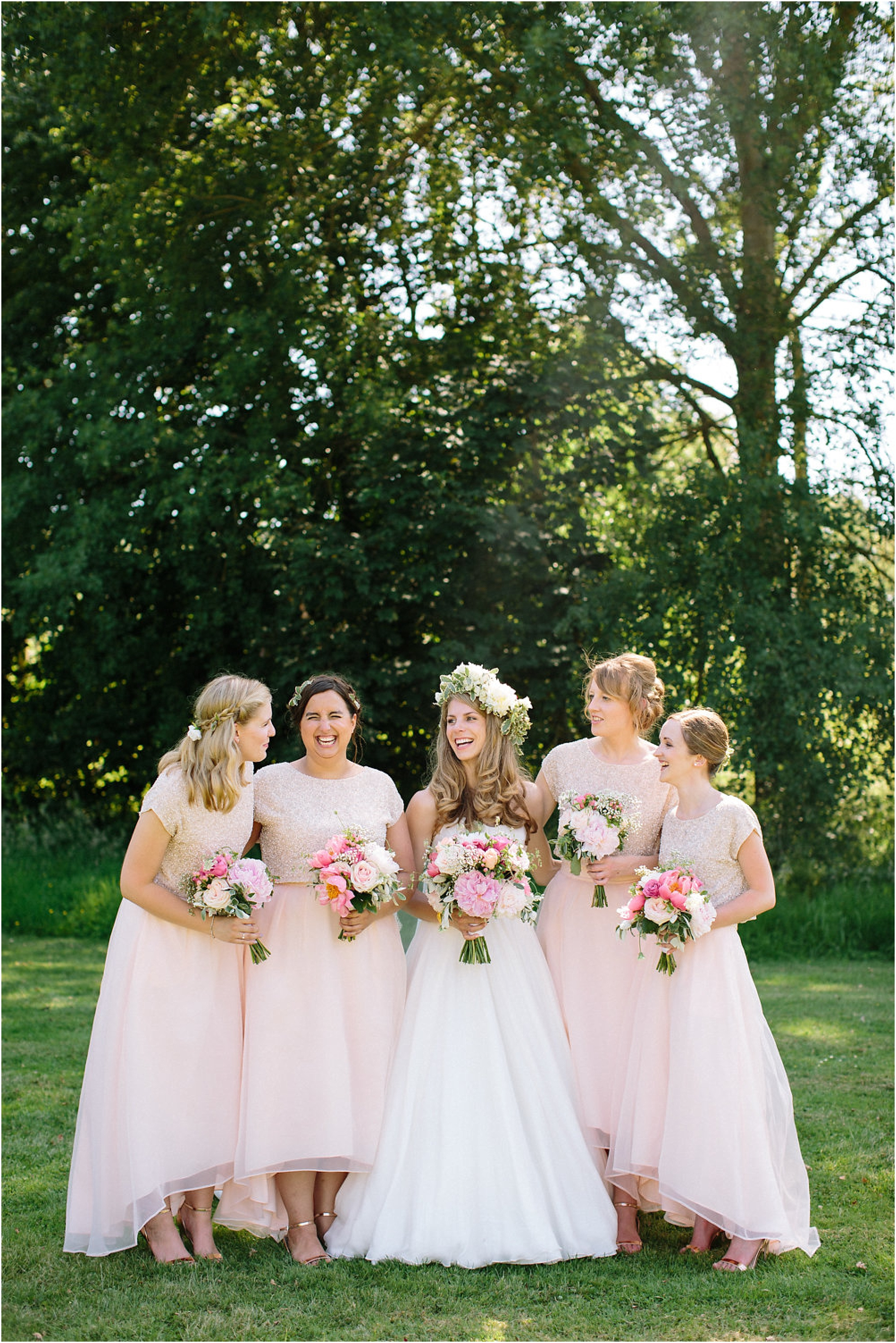 Bridesmaids in blush two piece dresses