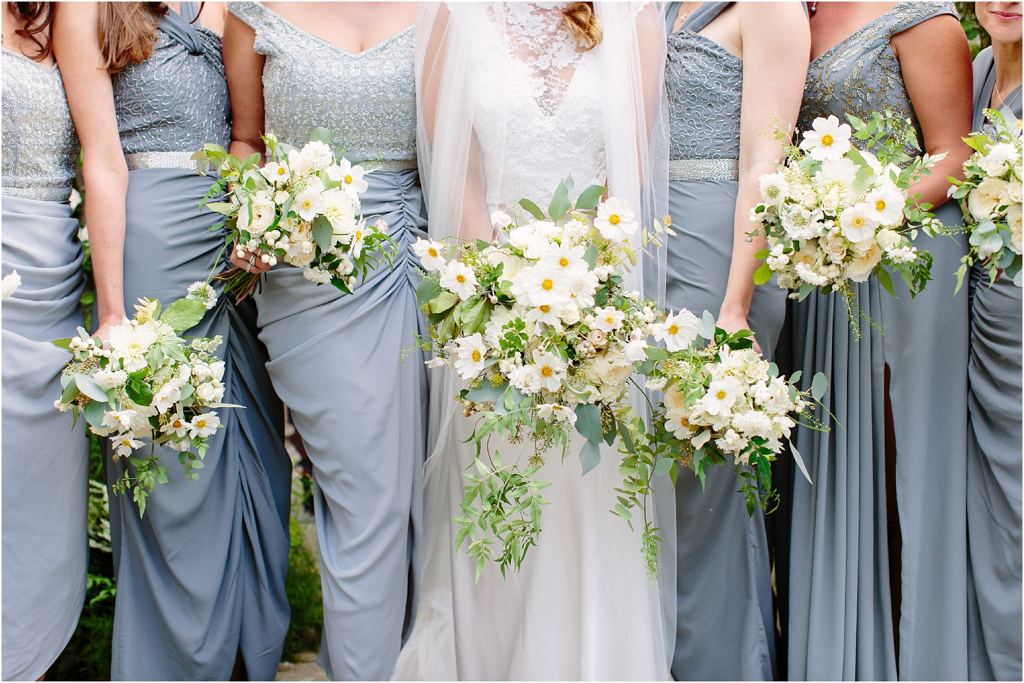 Bridesmaids in blue miss matched dresses