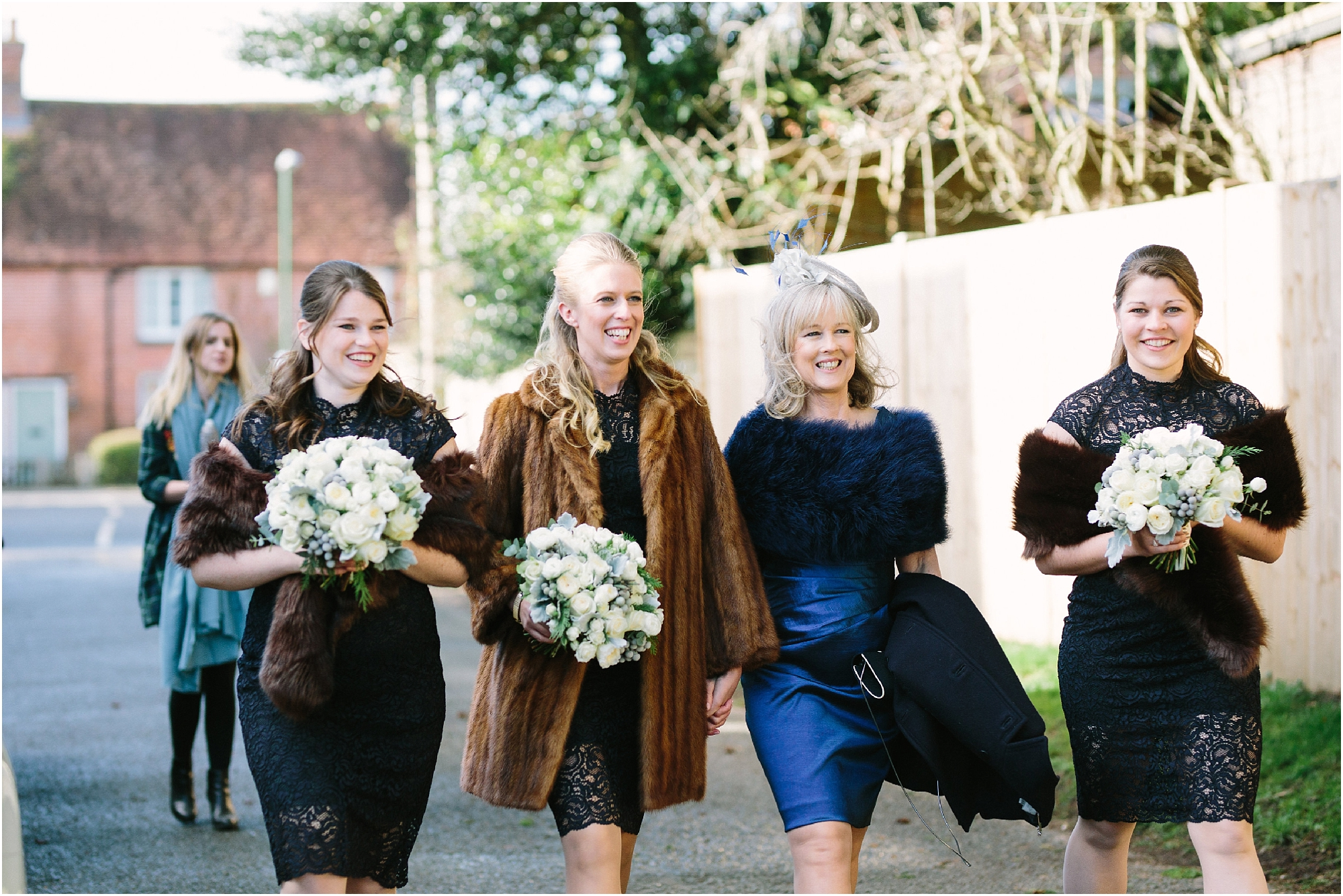 Bridesmaids in navy dresses with fur