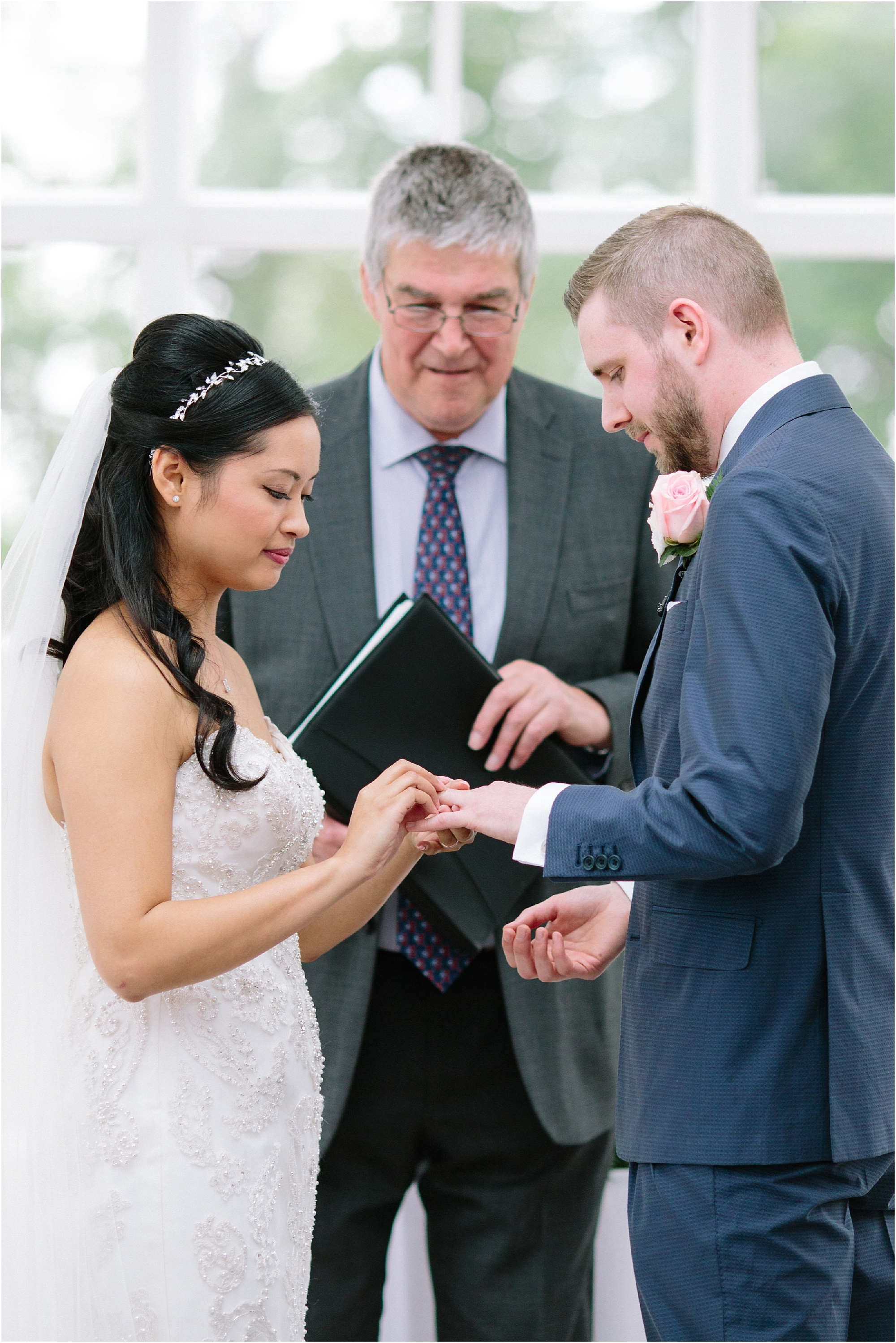 Couple exchanging rings during wedding ceremony