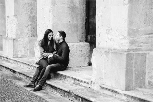 couple sitting on steps laughing