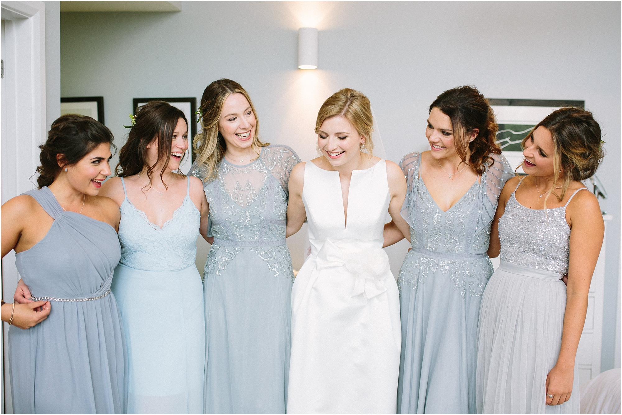 bride with bridesmaids in shades of blue