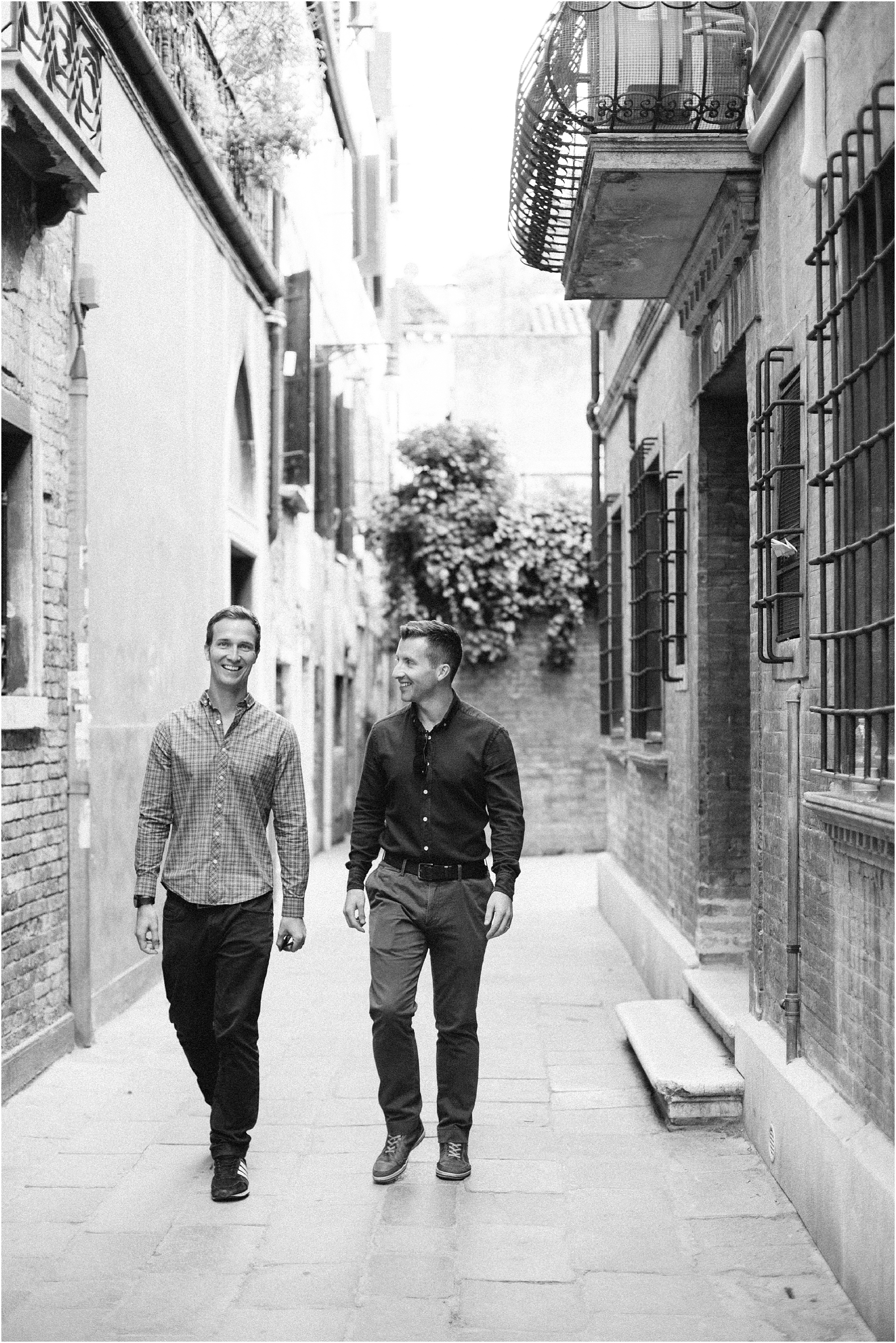 Male couple walking in Venice Italy