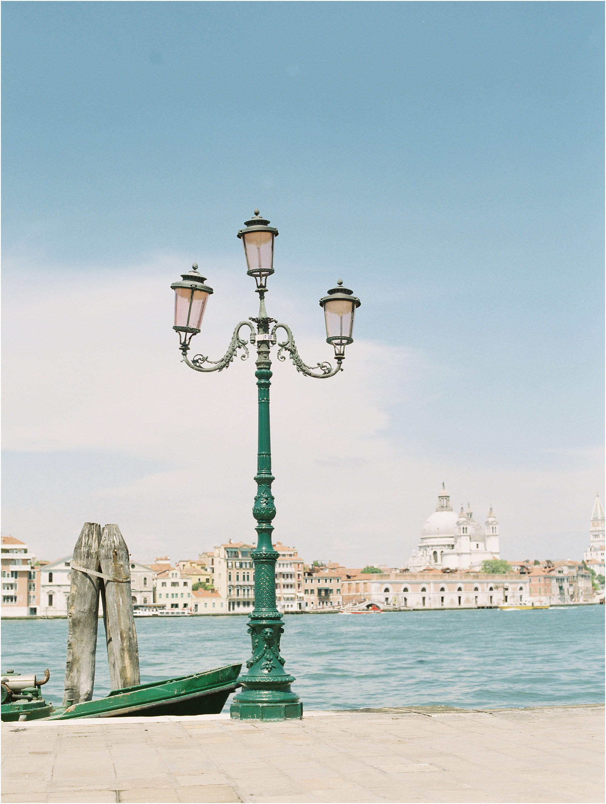 Lamp post with Venice in the background