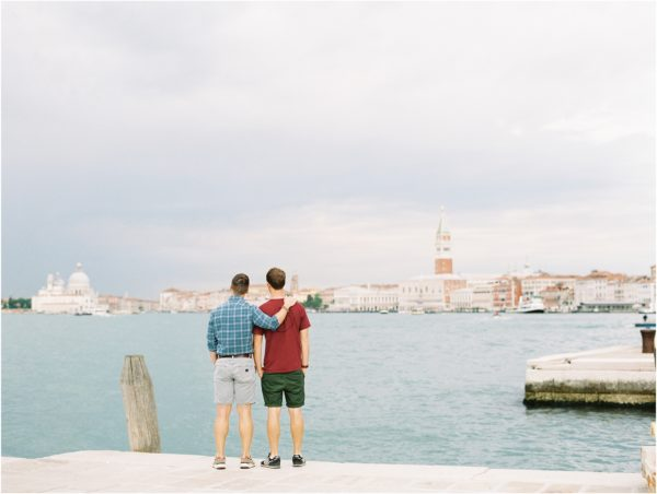 Gay couple looking out over Venice Italy