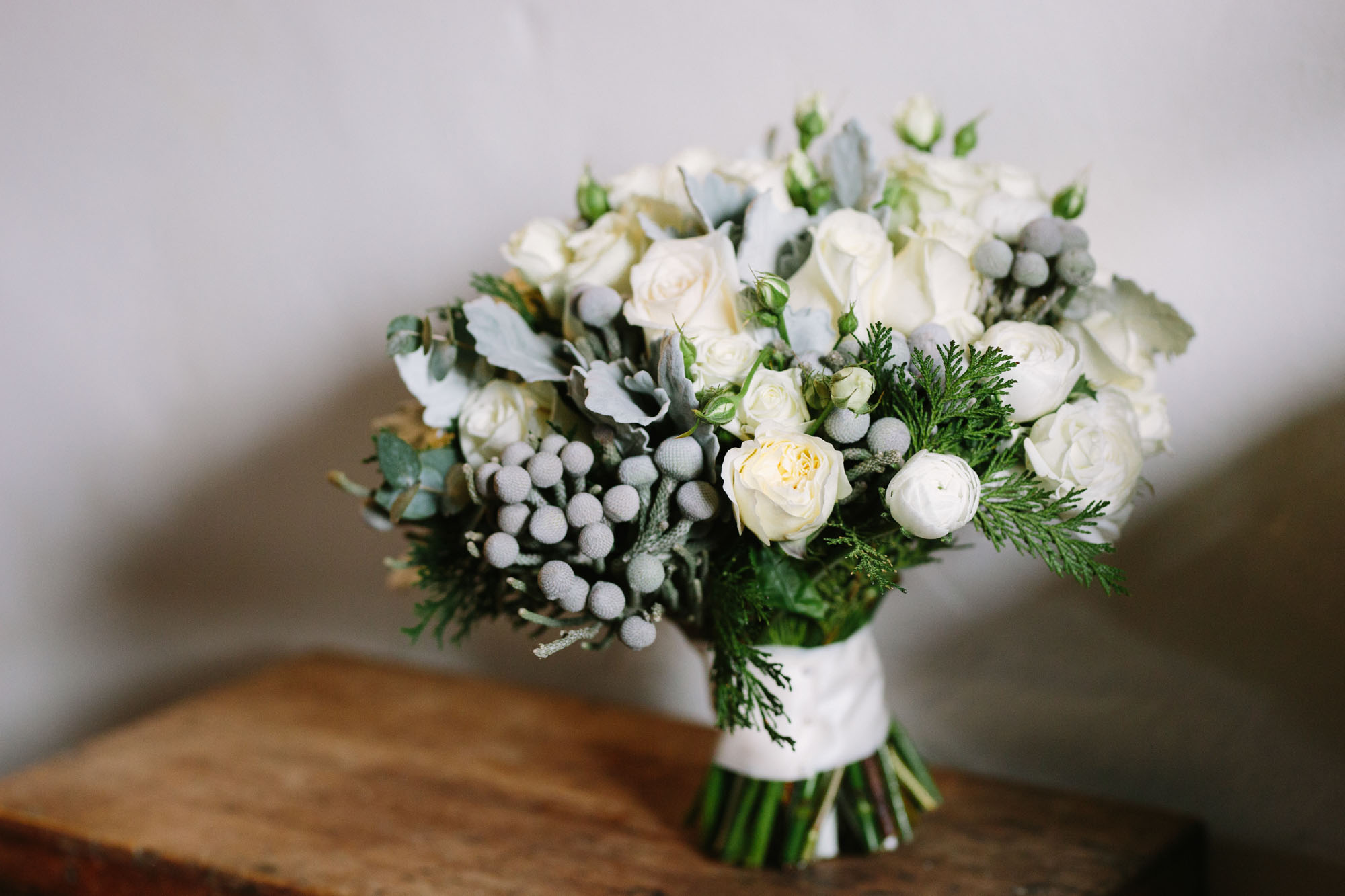 Green and white winter wedding bridal bouquet
