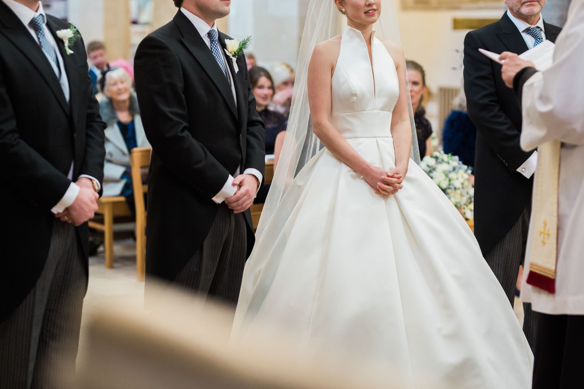Bride and groom standing at the alter of Boxgrove Priory