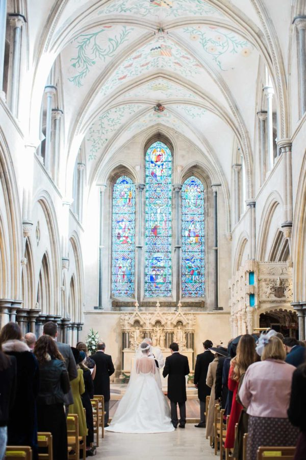 Bride and groom standing at the alter at Boxgrove Priory winter wedding
