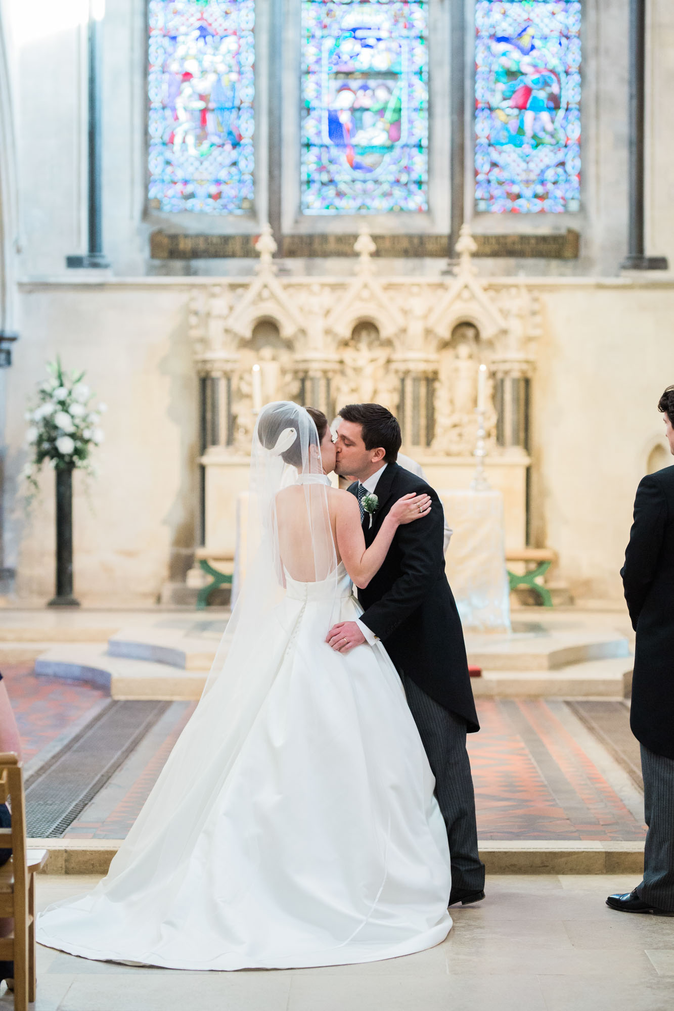 Bride and groom's first kiss at Boxgrove Priory wedding