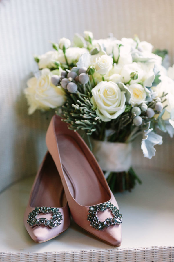 Pink wedding shoes with bridal bouquet