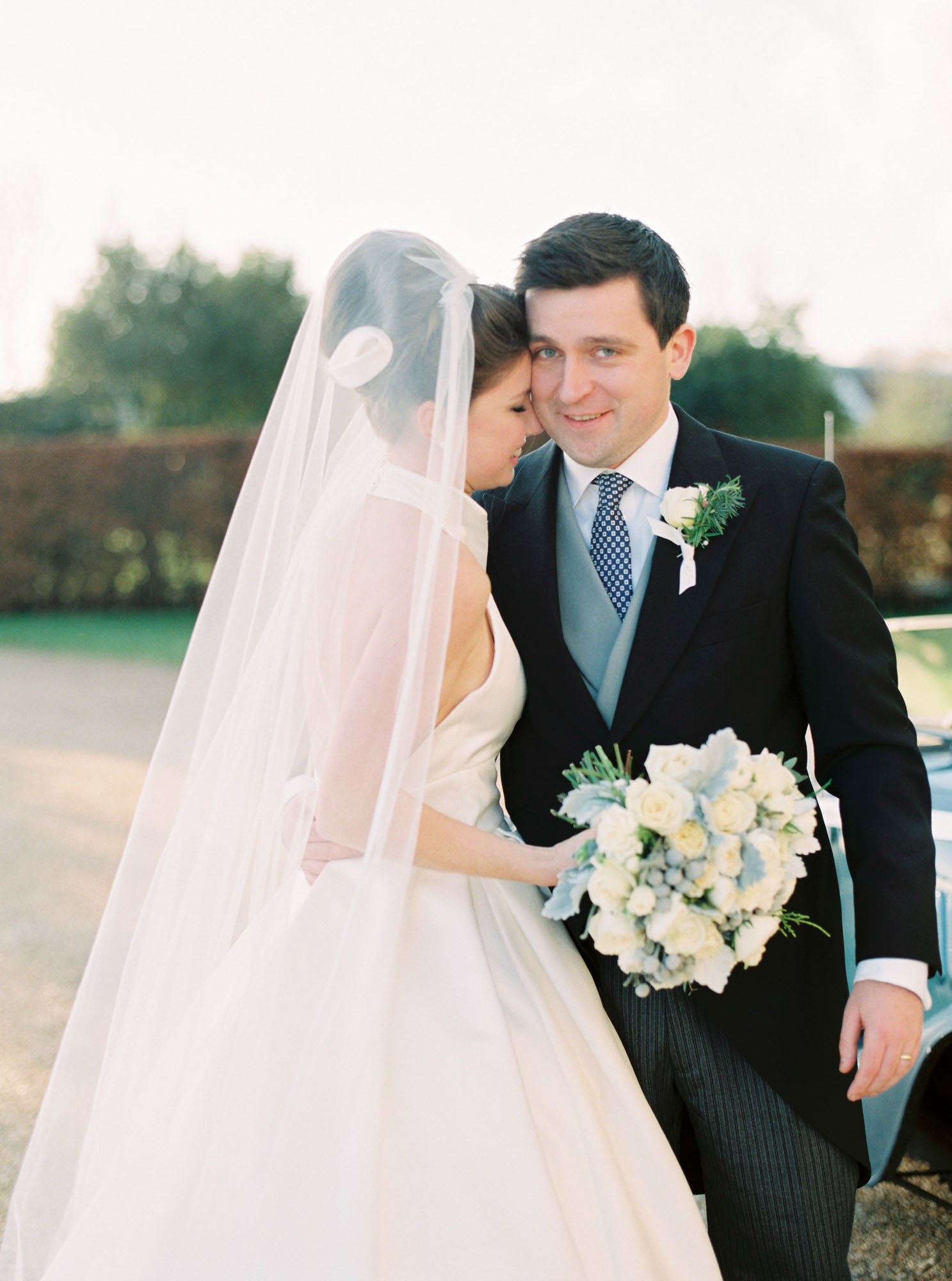 Romantic portrait of bride and groom at Goodwood House wedding