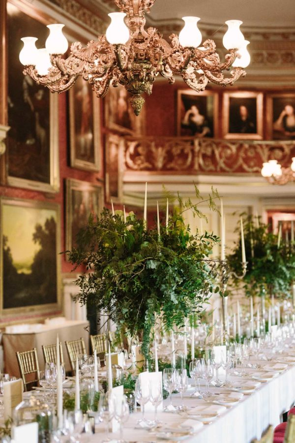 Wedding breakfast room set up with flower by Albert & Arthur at Goodwood House wedding