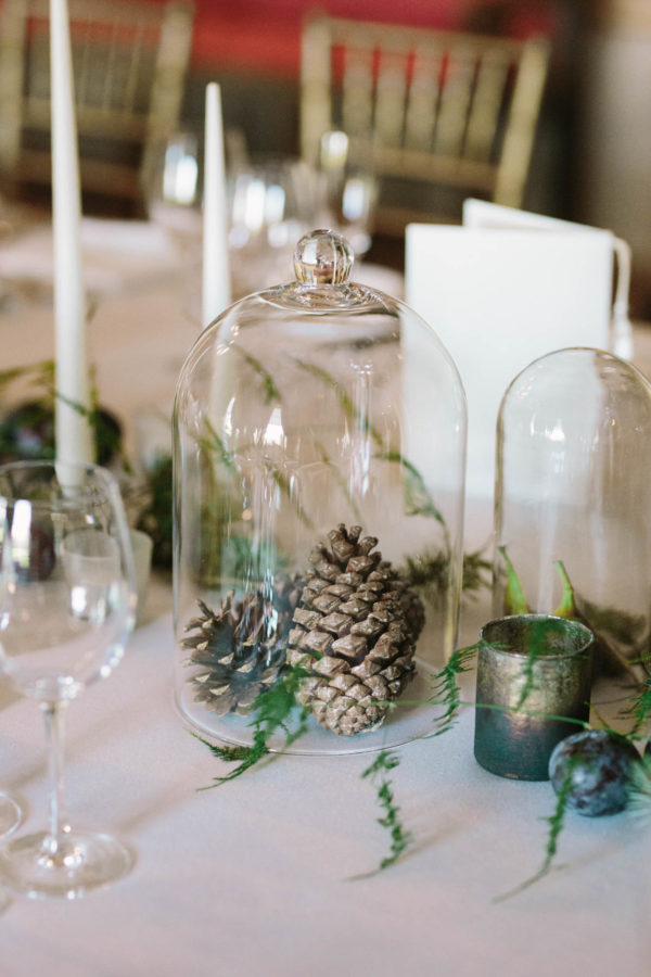 Pinecones under glass cover on the table of Goodwood House wedding