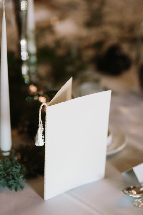 Wedding menu with silk tassel at Goodwood House wedding