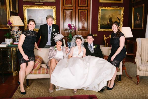 Laid back family portrait at Goodwood House wedding