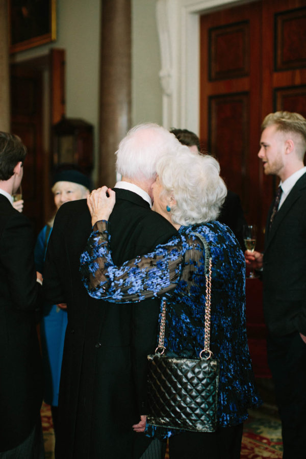 Elderly couple kissing at Goodwood House wedding
