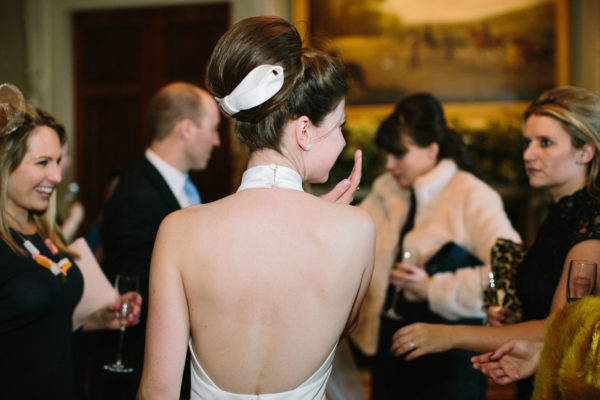 Back of brides Jesus Peiro wedding dress at Goodwood House wedding