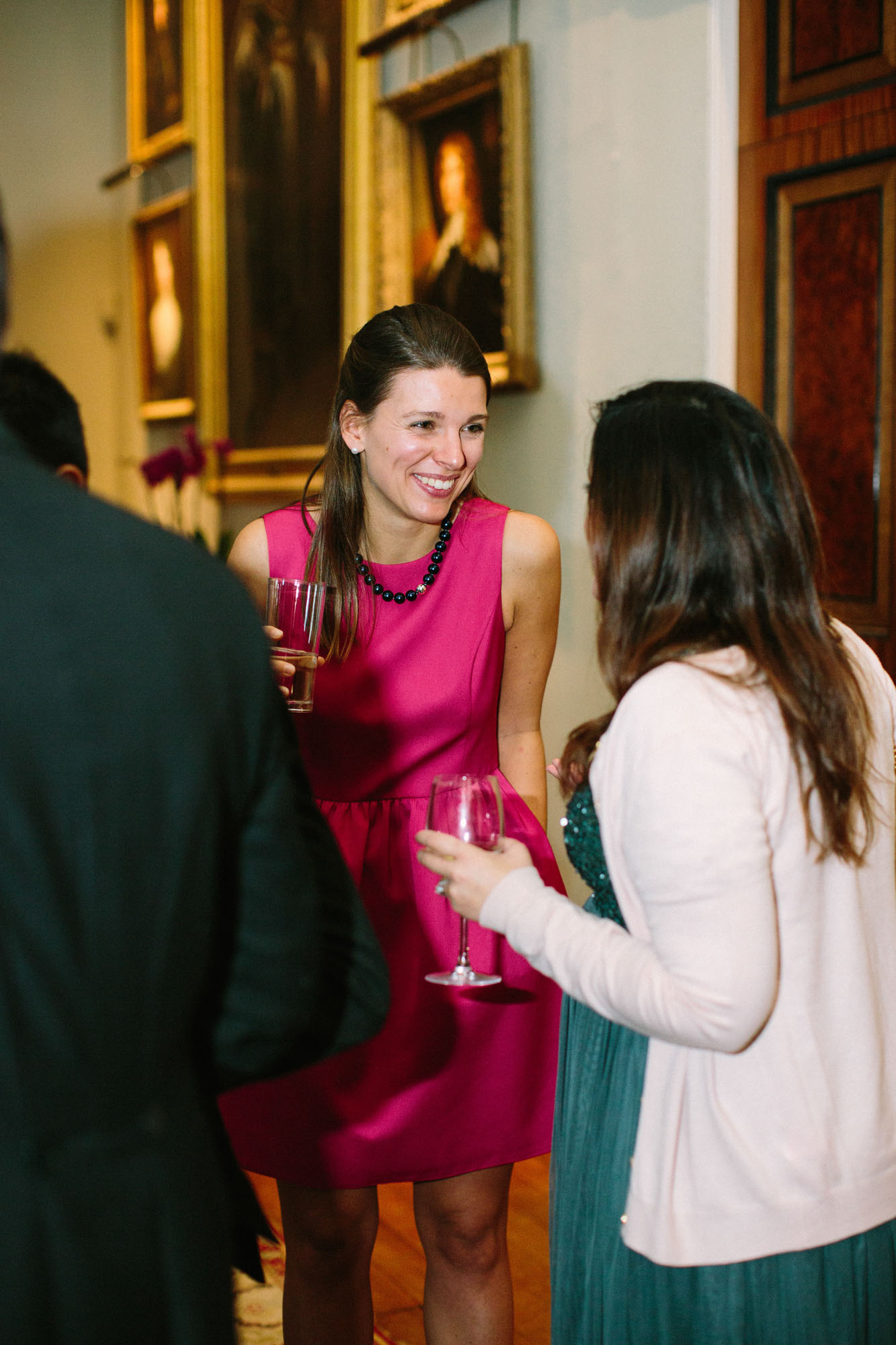 Wedding guests laughing and chatting at Goodwood House