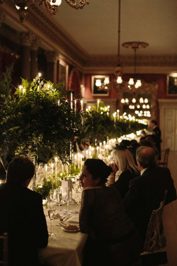 Atmospheric evening photograph of wedding breakfast at Goodwood House wedding