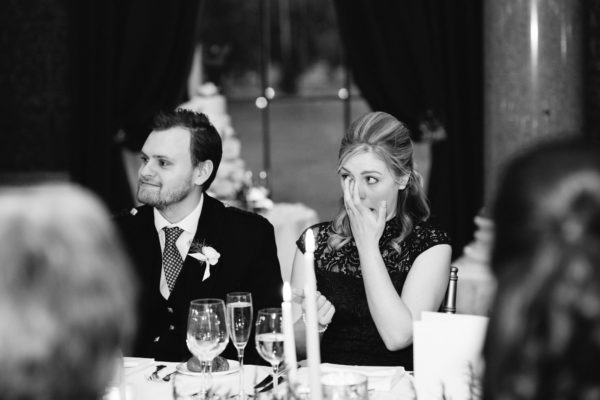 Wedding guests crying during speeches at Goodwood House wedding