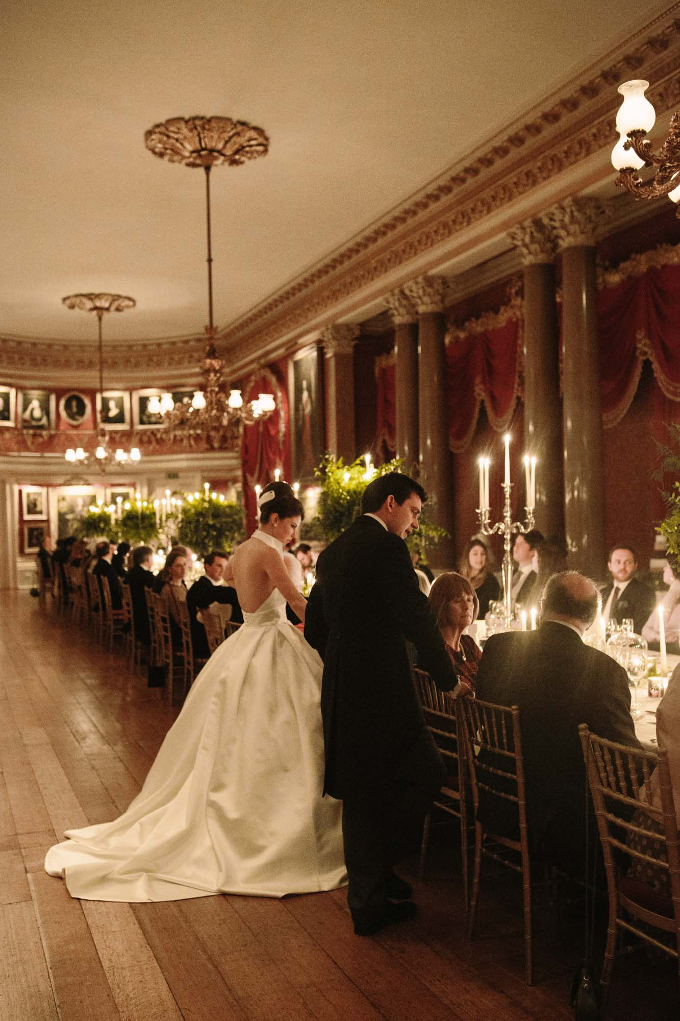 Bride and groom chatting to guests during wedding breakfast at Goodwood House