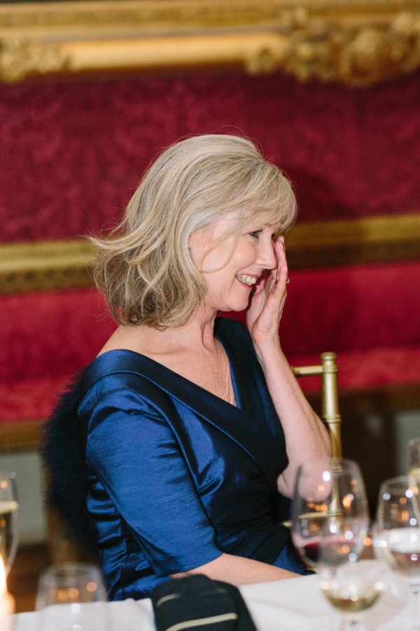 Mother of the bride crying during wedding speeches at Goodwood House