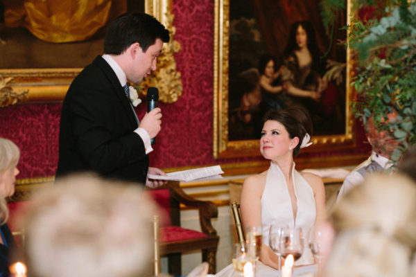 Bride looking at groom during wedding speech at Goodwood House