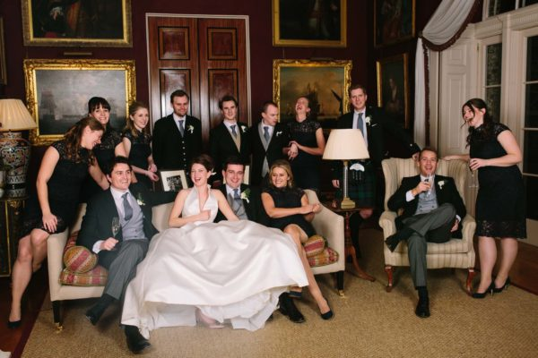 Relaxed bridal party photograph in the lounge at Goodwood House